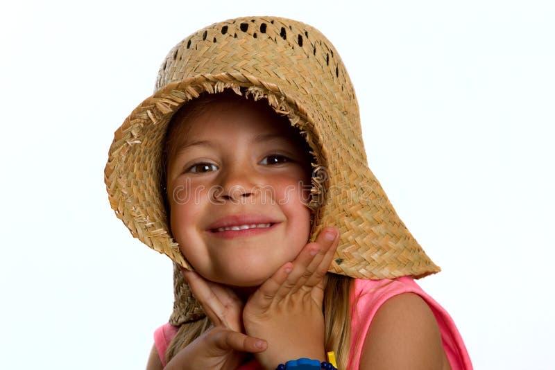 Meisje dat een strohoed draagt stock afbeeldingen