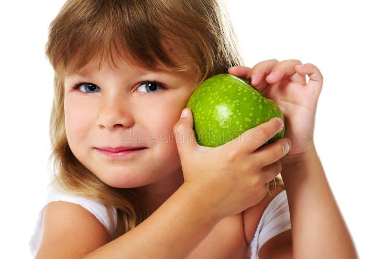 Meisje dat groene appel houdt stock afbeelding