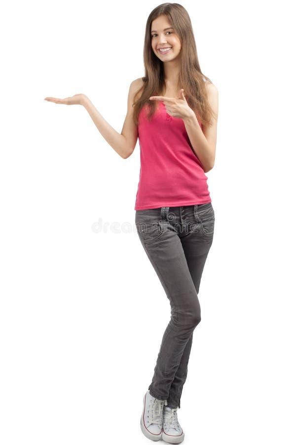 Meisje dat iets op de palm toont stock foto