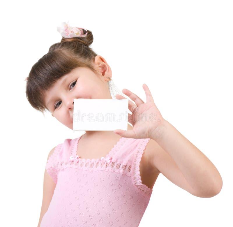 Meisje dat lege witte raad houdt stock foto's