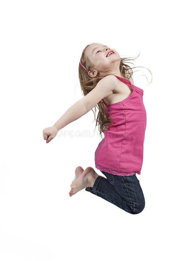 Meisje dat in lucht springt stock afbeelding