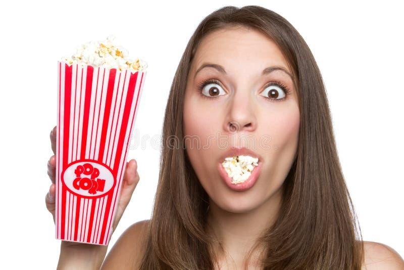 Meisje dat Popcorn eet stock afbeelding