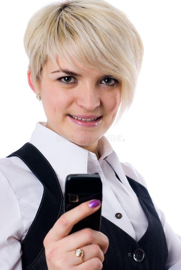 Meisje dat sms schrijft stock afbeelding