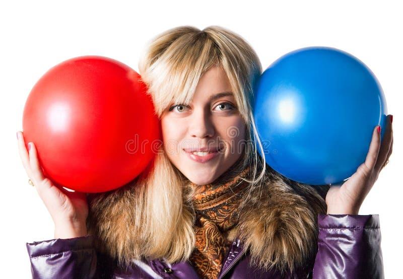 Meisje dat twee ballen houdt royalty-vrije stock foto