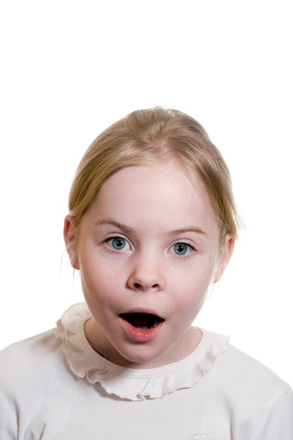Meisje dat verbazing uitdrukt stock foto