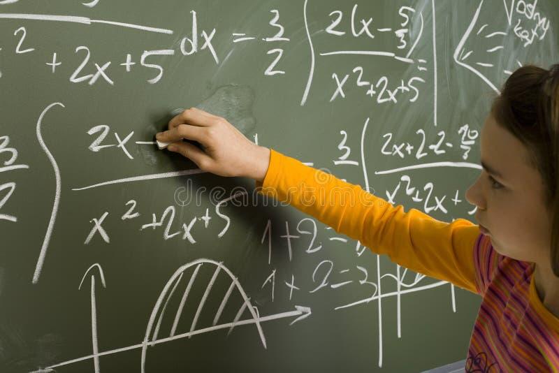 Meisje dat wiskunde doet royalty-vrije stock foto