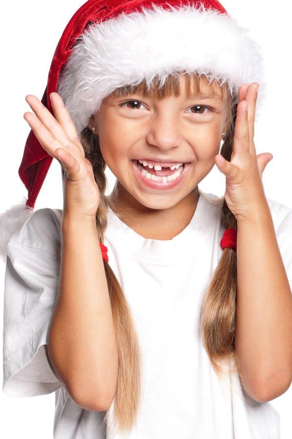 Meisje in de hoed van de Kerstman royalty-vrije stock foto's