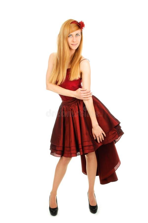 Meisje in de rode kleding stock foto