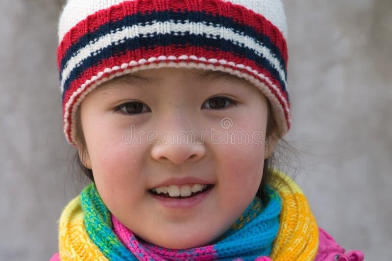 meisje in de winteruitrustingen royalty-vrije stock foto