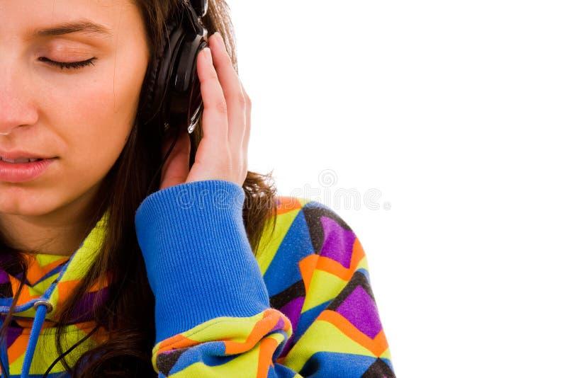 Meisje die aan Muziek luisteren stock afbeelding