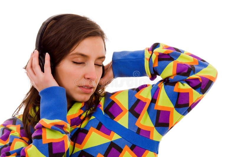 Meisje die aan Muziek luisteren stock afbeeldingen