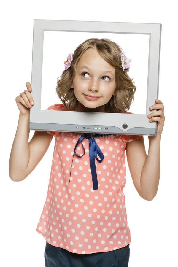 Meisje die door het het schermkader van TV/van de computer kijken stock afbeelding
