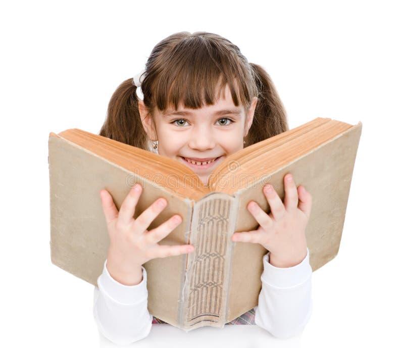 Meisje die groot boek houden Geïsoleerdj op witte achtergrond royalty-vrije stock foto's