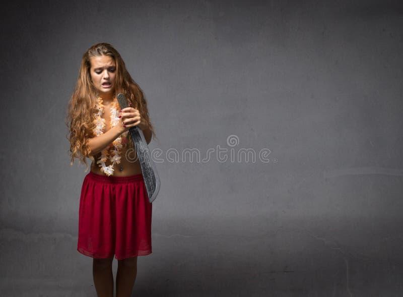 Meisje die groot mes gebruiken royalty-vrije stock fotografie