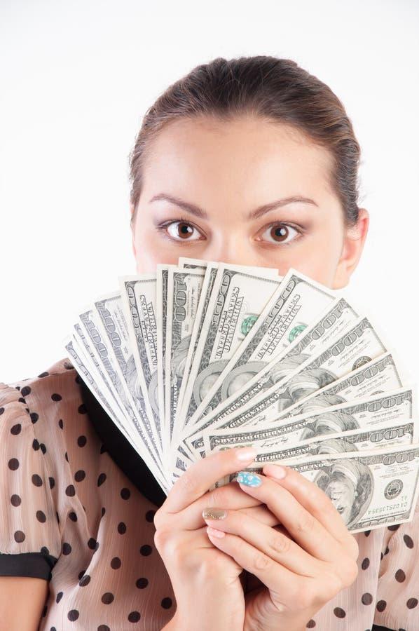 meisje die haar gezicht achter een geld verbergen royalty-vrije stock afbeelding