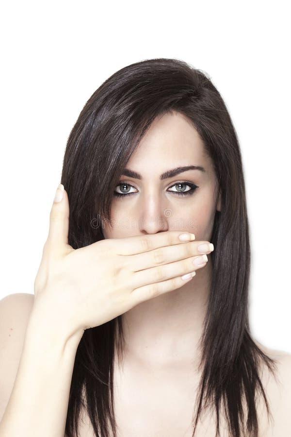 Meisje die haar mond gesloten houden stock afbeelding