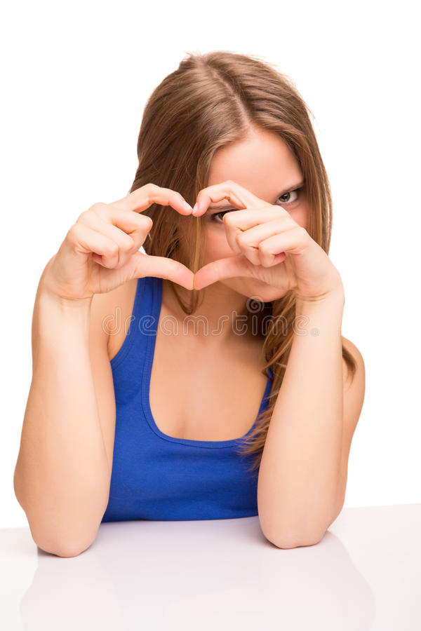 Meisje die liefdeteken doen stock foto