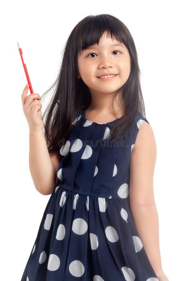 Meisje die met potlood denken royalty-vrije stock afbeeldingen
