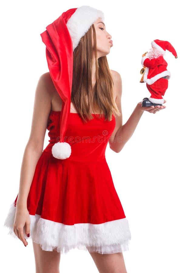 Meisje die Santa Claus-stuk speelgoed ter beschikking op wit geïsoleerde achtergrond bekijken royalty-vrije stock fotografie