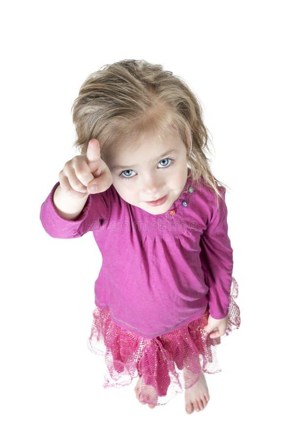 Meisje die wijsvinger tonen royalty-vrije stock foto's
