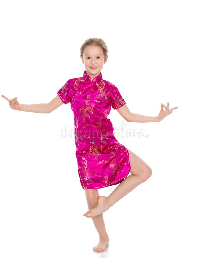 Meisje in een Chinese nationale kleding stock afbeeldingen