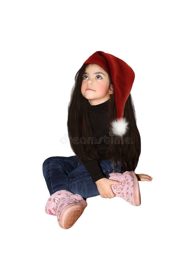 Meisje in een hoed van Santa Claus stock foto's