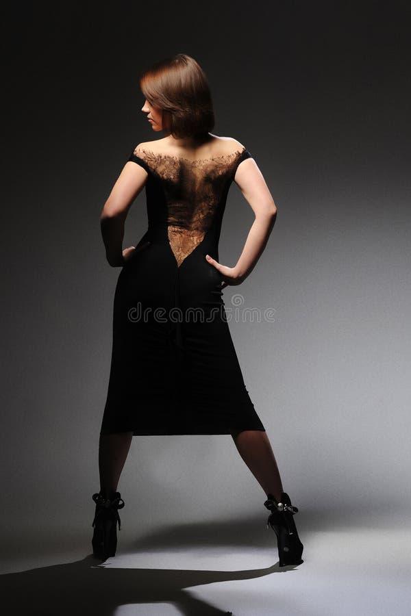Meisje in een kleding stock fotografie