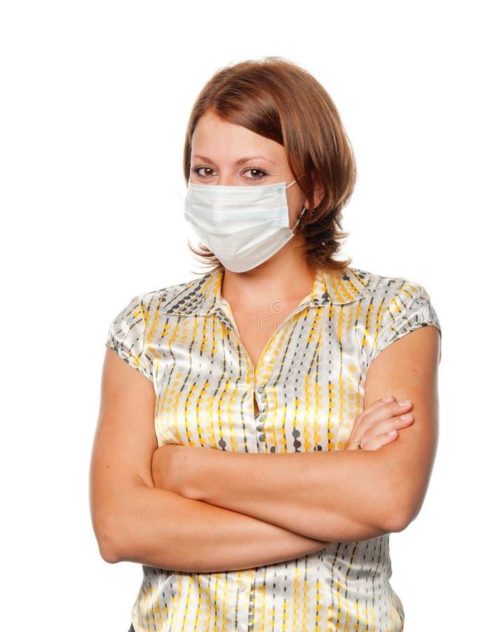 Meisje in een medisch masker stock foto