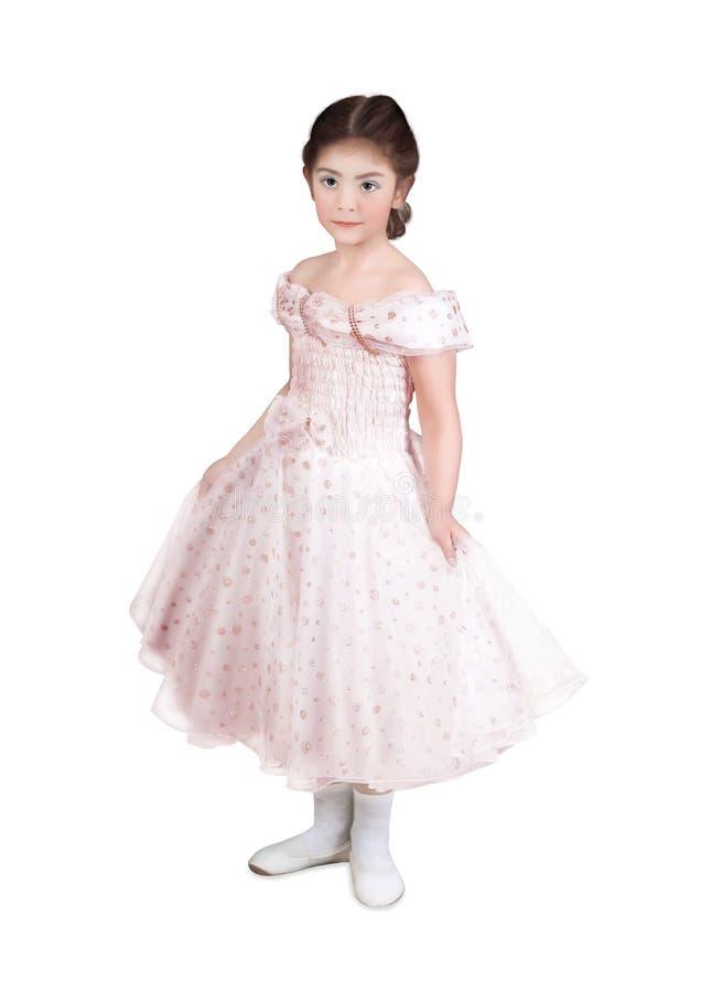 Meisje in een roze kleding stock afbeeldingen