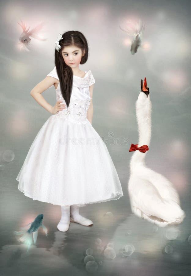 Meisje en een zwaan stock foto