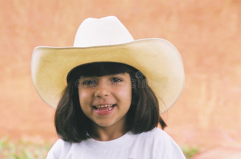 Meisje en hoed stock afbeelding
