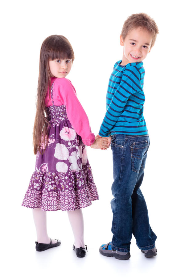 Meisje en jongen die terug kijken royalty-vrije stock afbeeldingen
