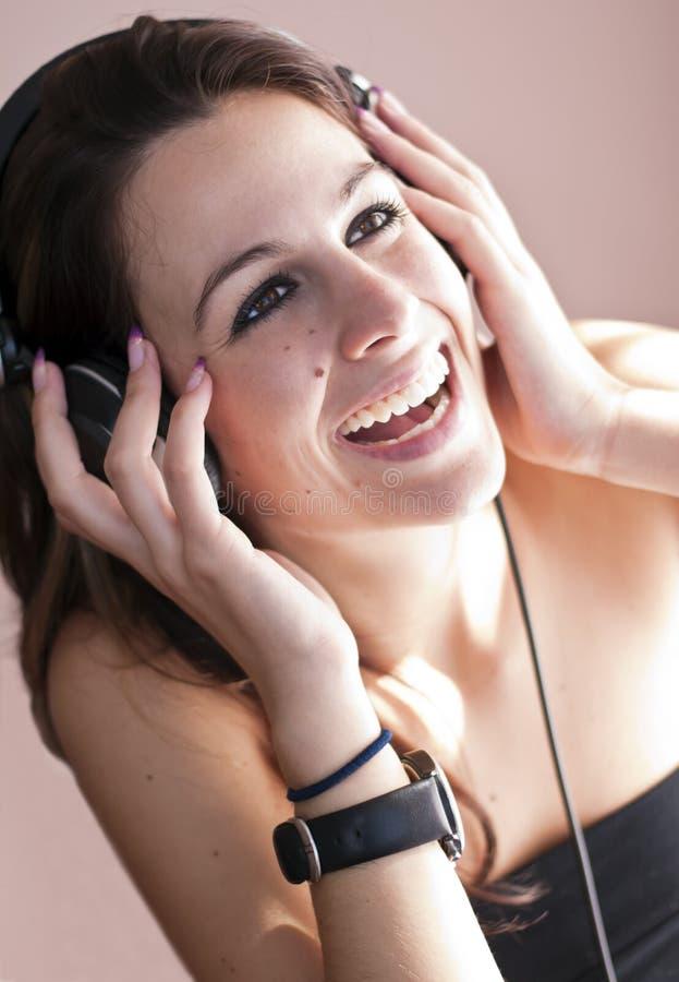 Meisje en muziek stock foto's