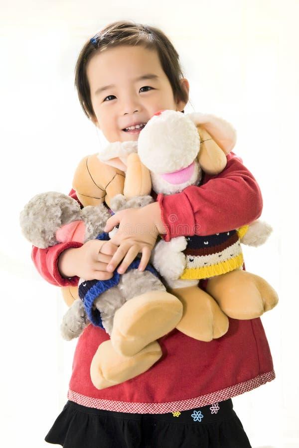 Meisje en speelgoed royalty-vrije stock foto