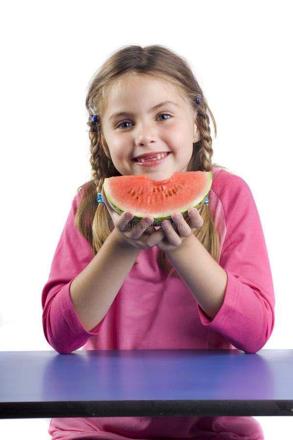 Meisje en watermeloen stock fotografie