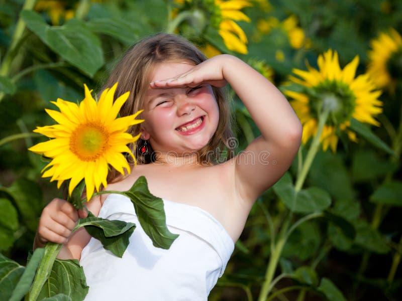 Meisje en zonnebloem stock foto