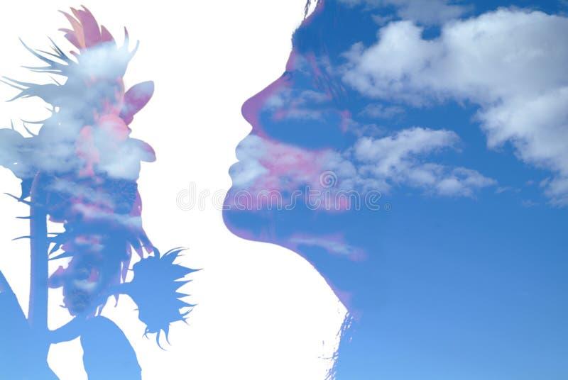 Meisje en zonnebloem stock afbeelding