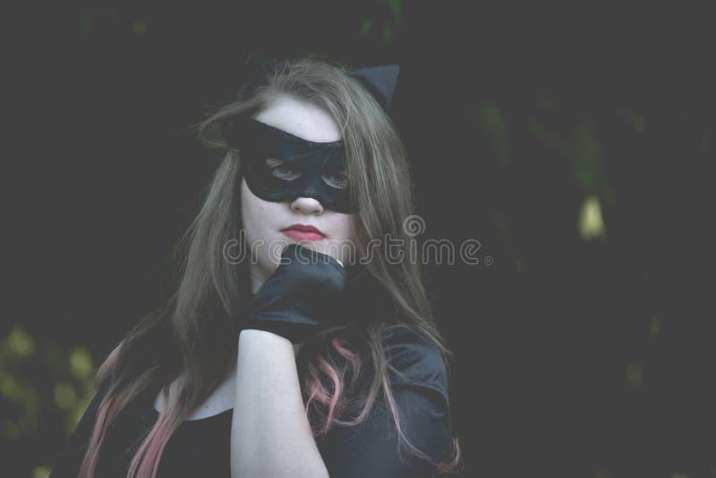 Meisje geklede Catwoman royalty-vrije stock afbeeldingen