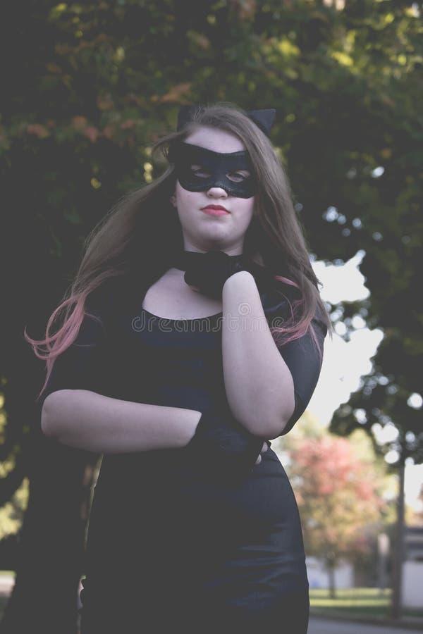 Meisje geklede Catwoman stock afbeelding