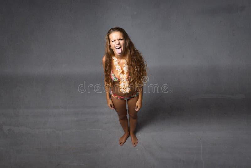 Meisje gemaakte gezichten royalty-vrije stock afbeeldingen