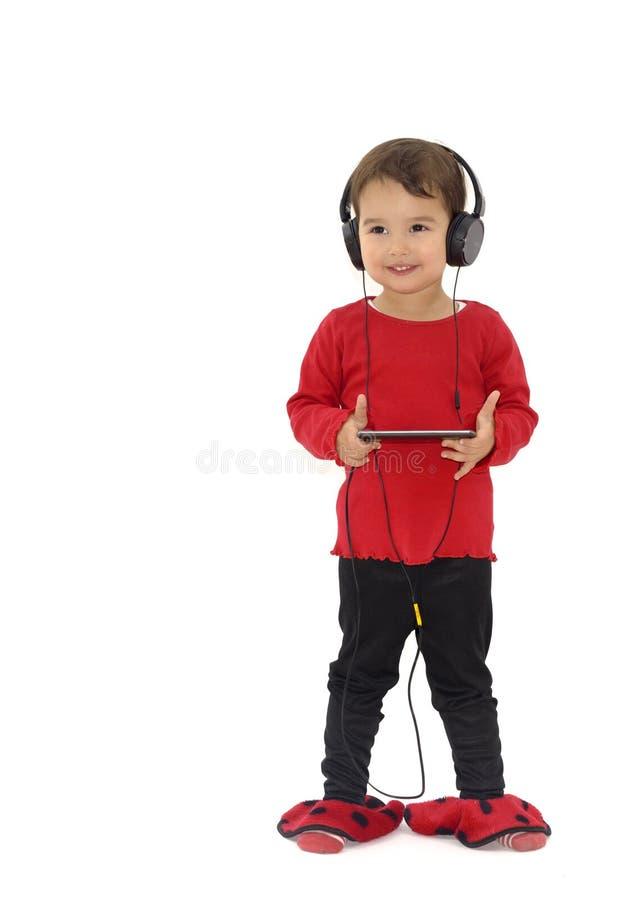 Meisje het luisteren geïsoleerde muziek met hoofdtelefoons, stock afbeelding