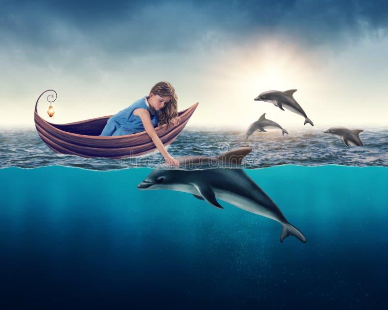 Meisje het spelen met dolfijn royalty-vrije stock afbeeldingen