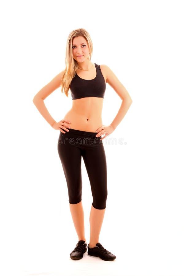 meisje in het sportkostuum stock fotografie