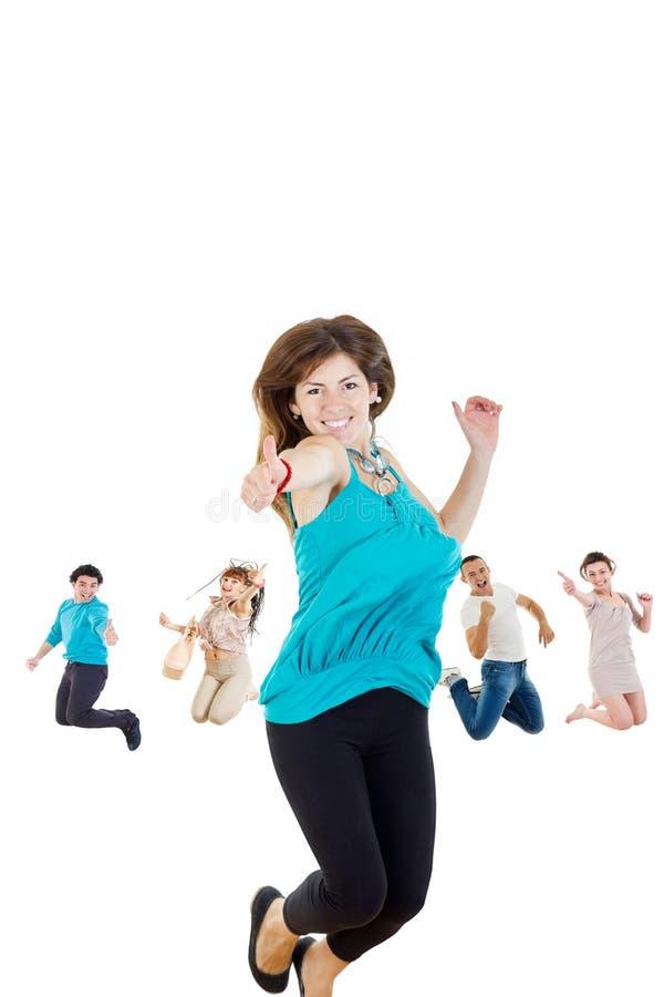 Meisje het springen met duim omhoog op van vreugde wekte geïsoleerd op witte bac stock afbeelding