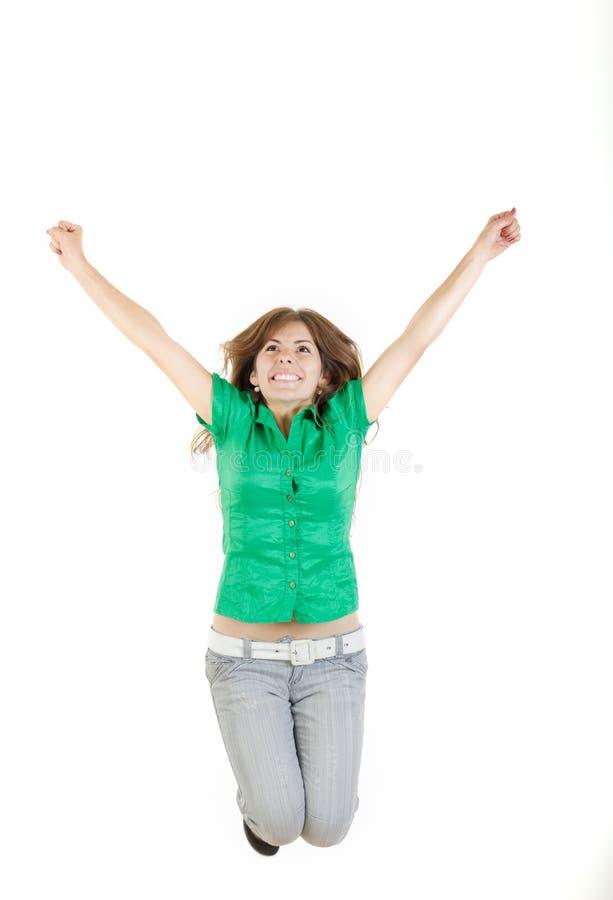 Meisje het springen met opgeheven wapens omhoog op van vreugde wekte geïsoleerd op whi stock foto