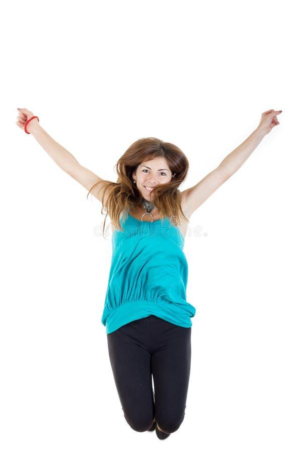 Meisje het springen van vreugde wekte geïsoleerd op witte achtergrond op royalty-vrije stock foto's