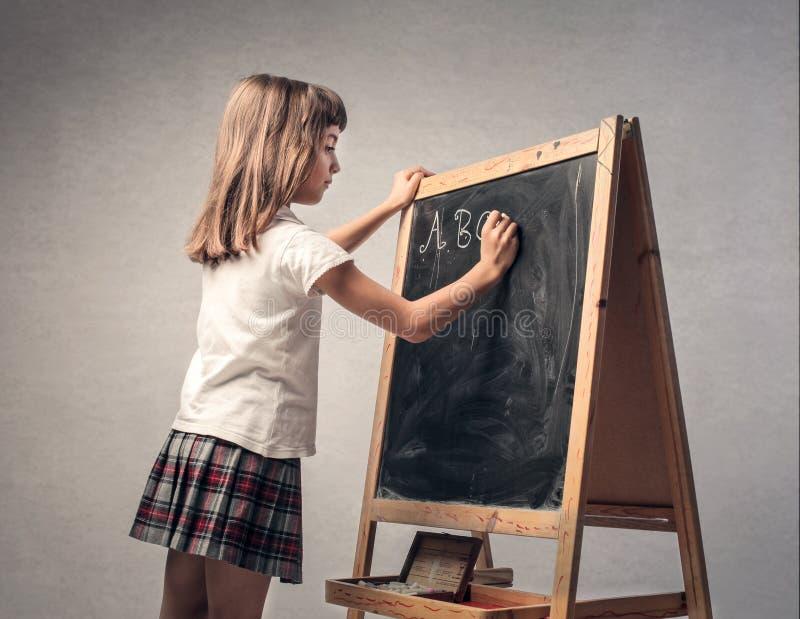 Meisje in klasse royalty-vrije stock fotografie