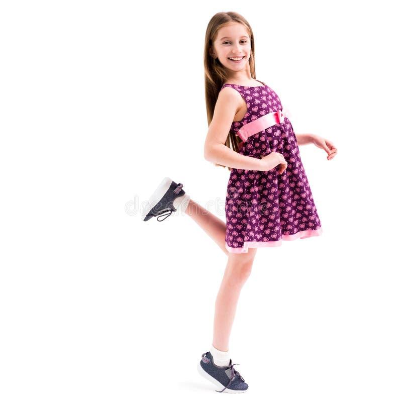 Meisje in kleding die, die en haar been stellen bewegen royalty-vrije stock foto's