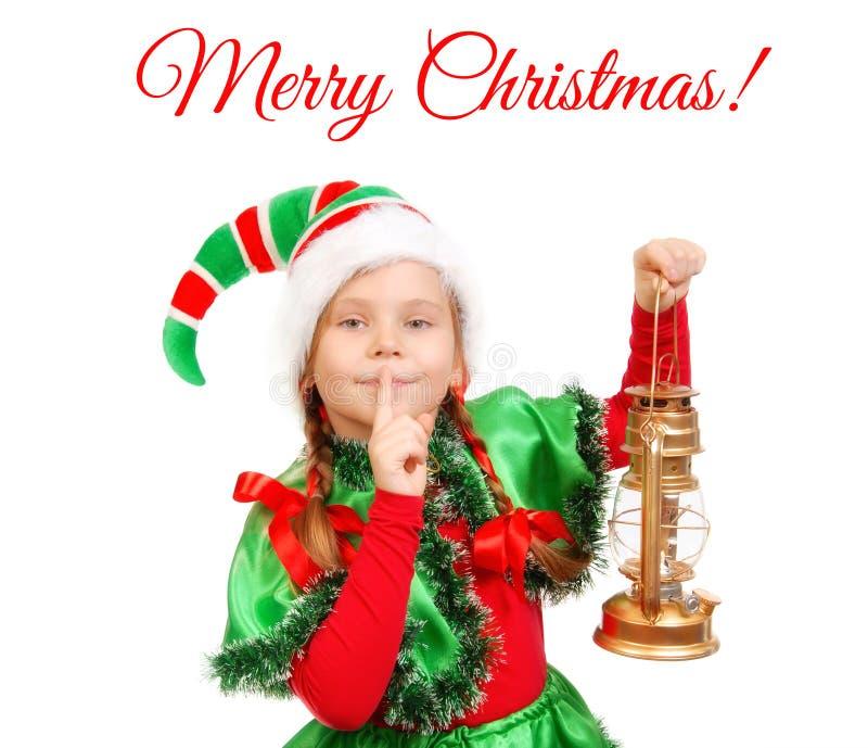 Meisje in kostuum van het elf van Kerstmis met olielamp royalty-vrije stock fotografie