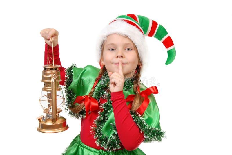 Meisje in kostuum van het elf van Kerstmis met olielamp royalty-vrije stock foto
